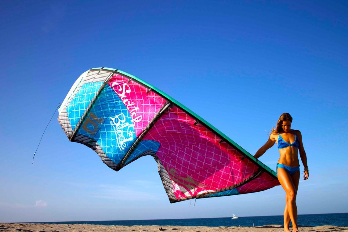 Melissa Gil with the Cabrinha Switchblade kite - in bikini on the beach