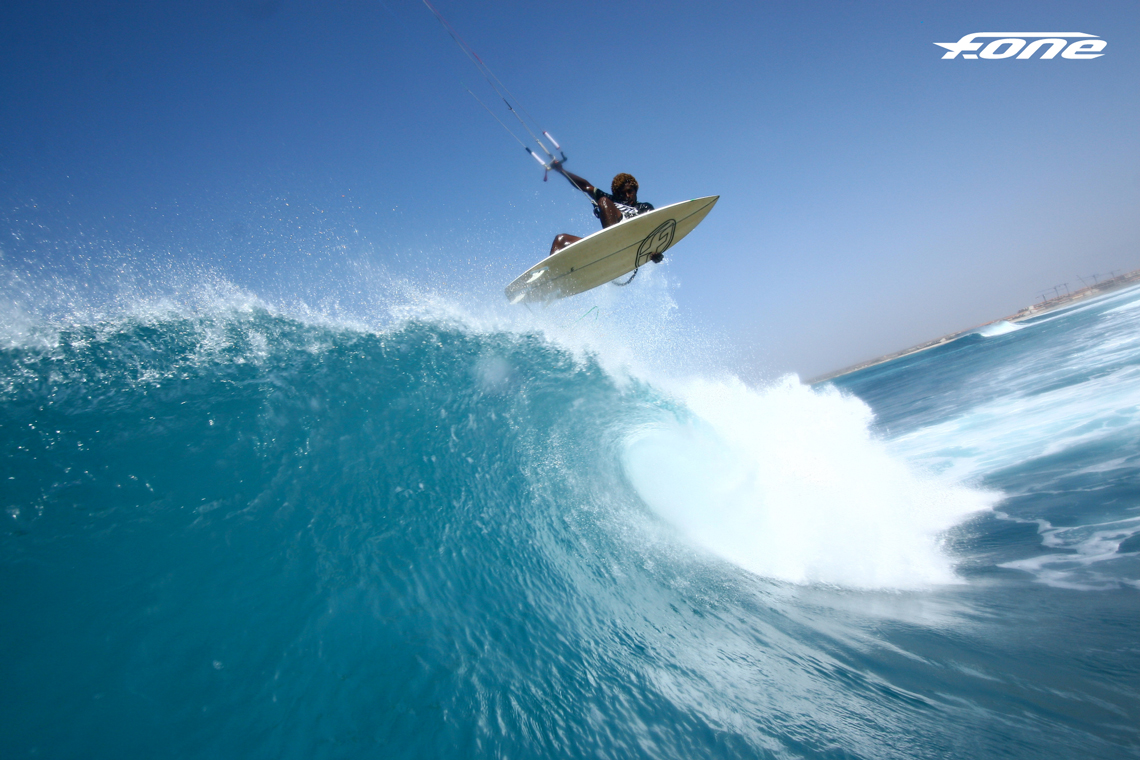 Kitesurfer Mitu Monteiro getting some air off a nice wave - fone kites