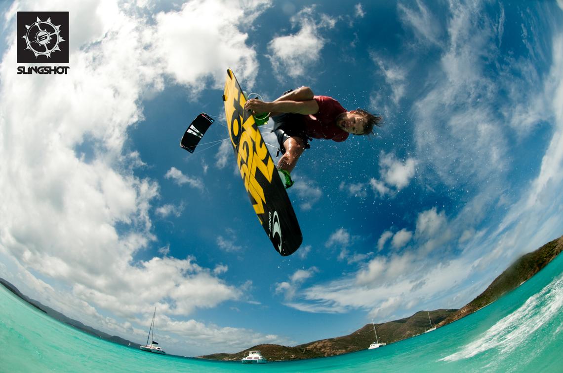 Sam Light kitesurfing on the 2015 Slingshot Fuel and Asylum board - inverted over lagoon