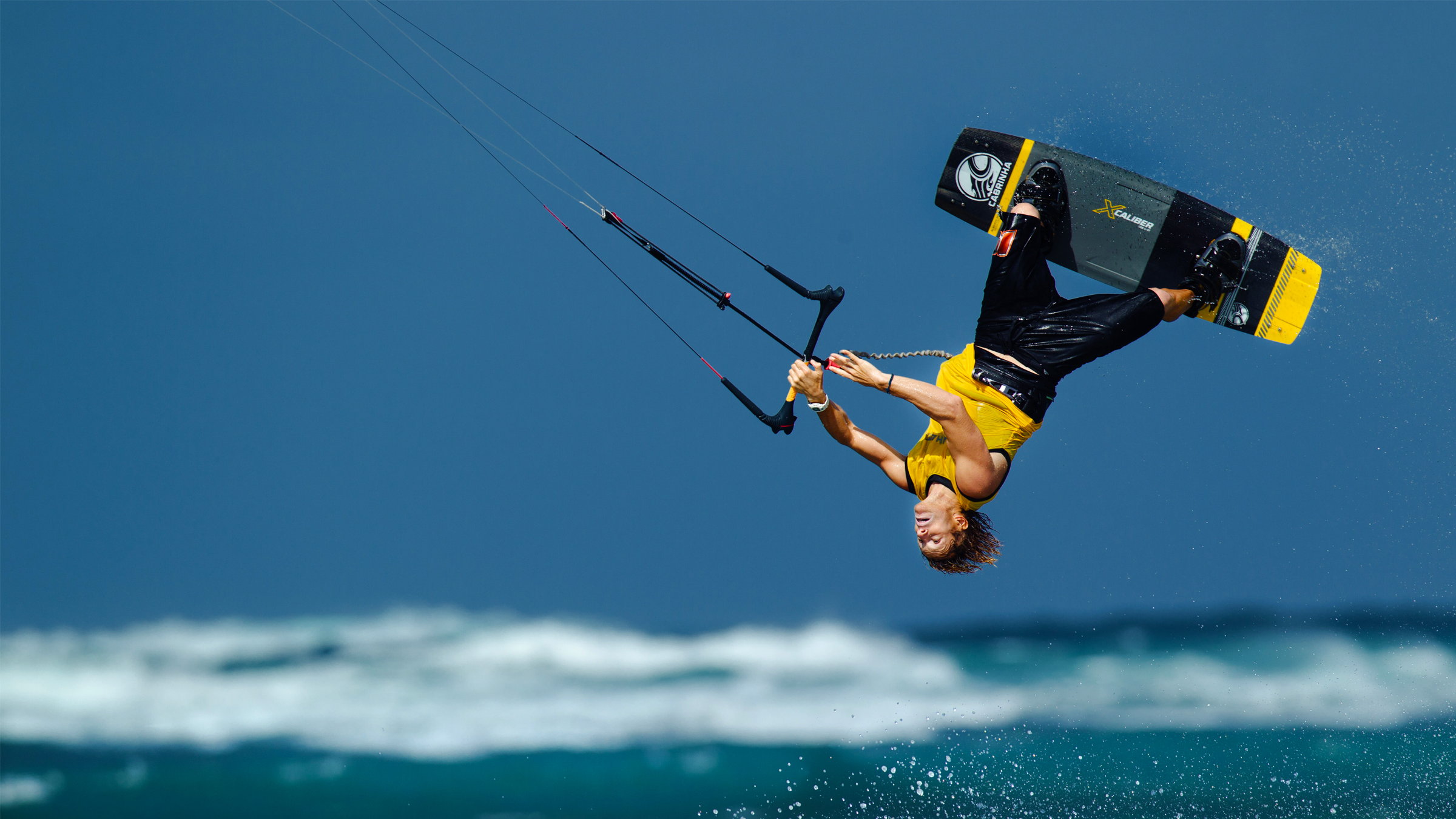 kitesurf wallpaper image - Alberto Rondina inverted on the Cabrinha Xcaliber full carbon board - kitesurfing - in resolution: High Definition - HD 16:9 2400 X 1350