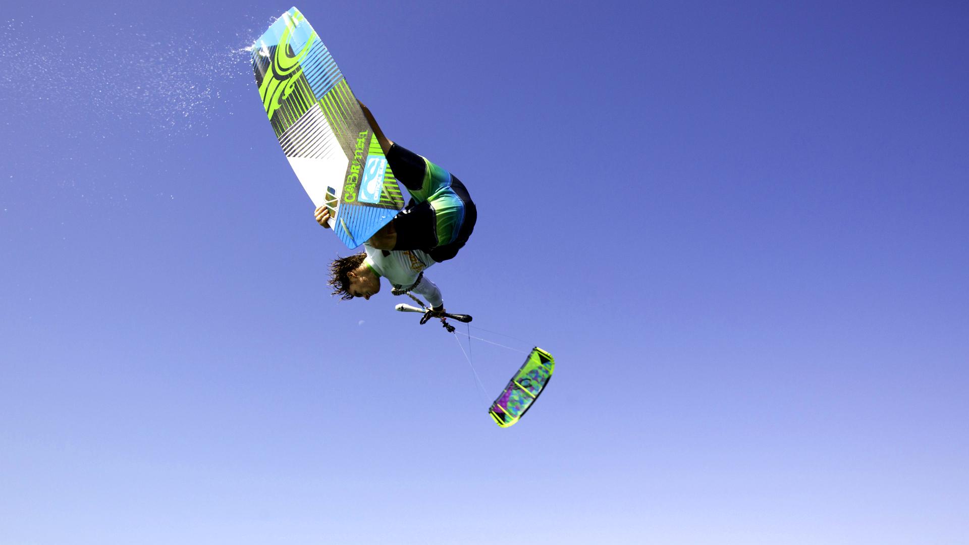 kitesurf wallpaper image - The Cabrinha Chaos kite in action - board grab kitesurfing - in resolution: High Definition - HD 16:9 1920 X 1080