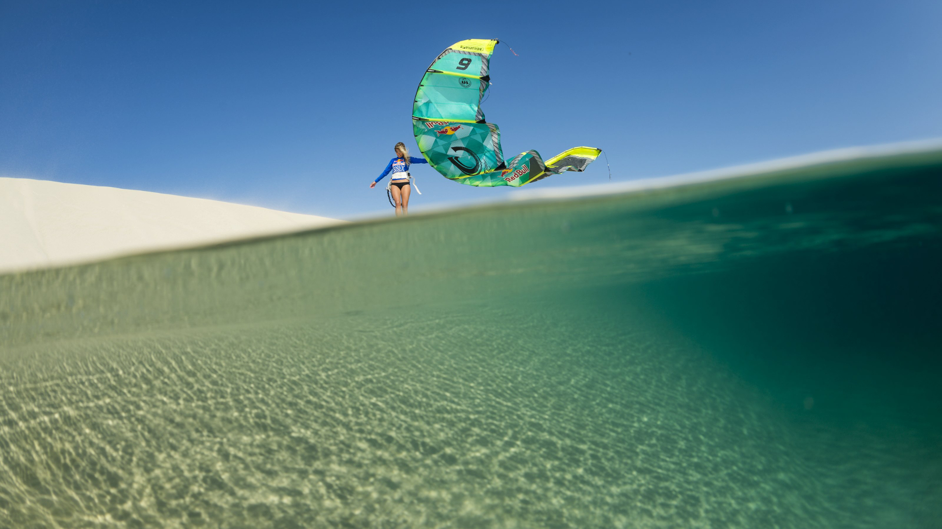 kitesurf wallpaper image - Susi Mai just hanging out with her Cabrinha kite on a sand dune - in resolution: High Definition - HD 16:9 1920 X 1080