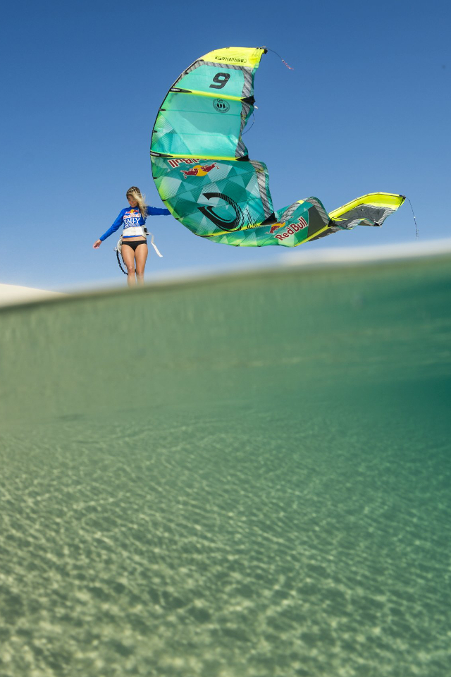 kitesurf wallpaper image - Susi Mai just hanging out with her Cabrinha kite on a sand dune - in resolution: iPhone 640 X 960