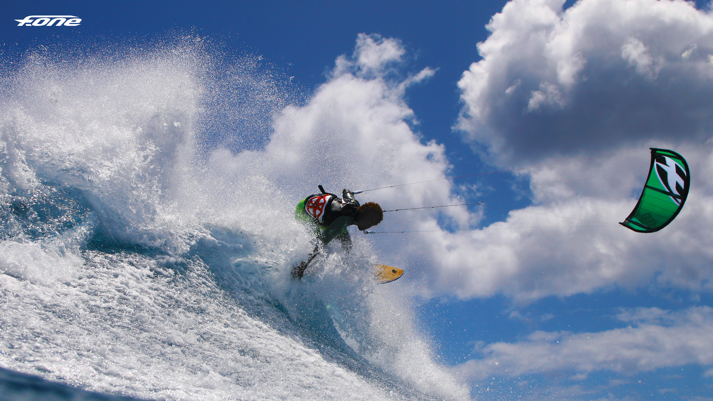 kitesurf wallpaper image - Backside shred by Mitu Monteiro off a wave and on the F-One Bandit kite. - in resolution: High Definition - HD 16:9 2400 X 1350