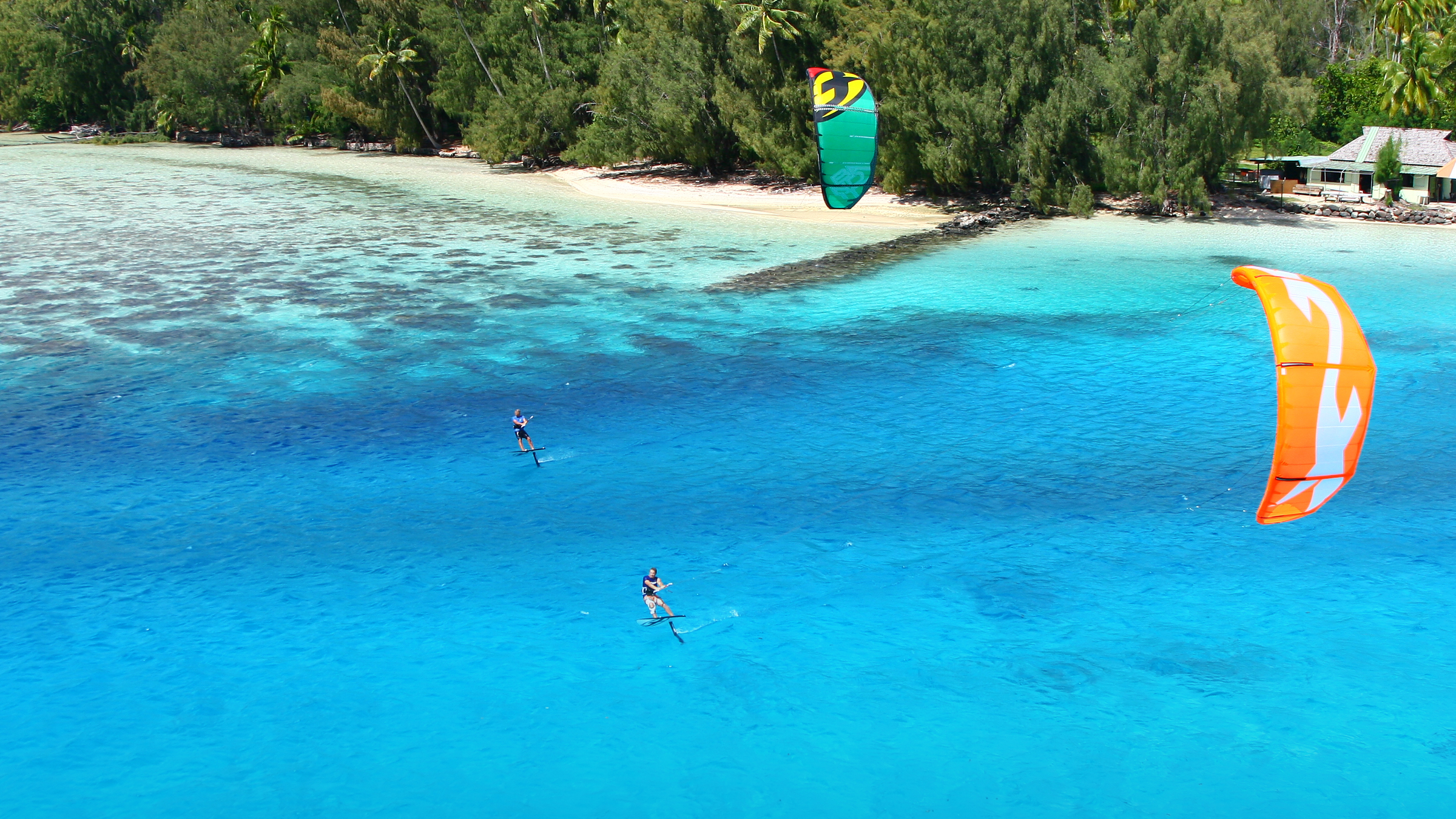 kitesurf wallpaper image - Cruising on the foilboards with the 2015 F-One Bandit - kitesurfing in tropical waters - in resolution: High Definition - HD 16:9 2400 X 1350