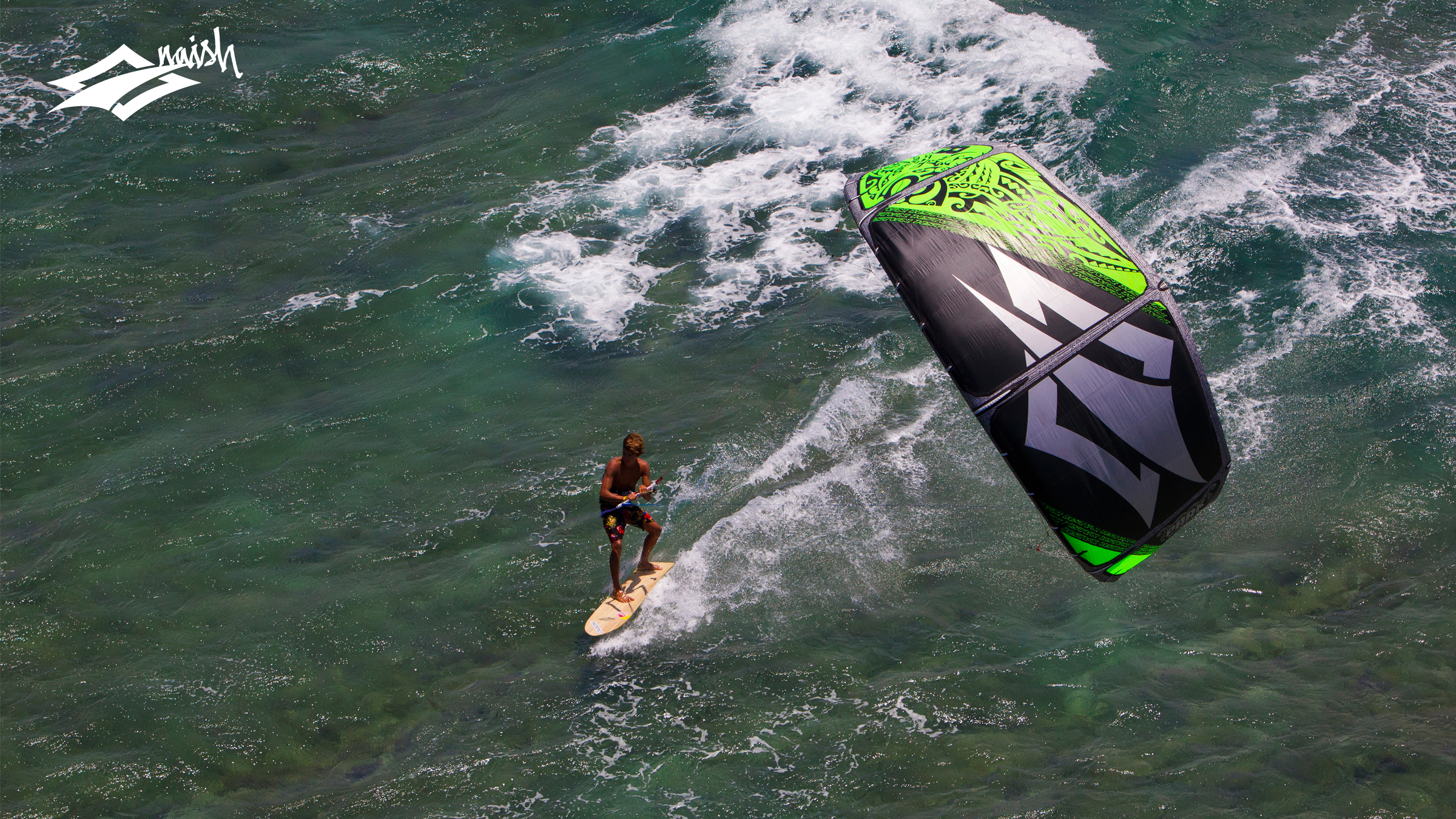 kitesurf wallpaper image - Kai Lenny cruising with the Naish Park kite and Alaia kiteboard off Hawaii - in resolution: High Definition - HD 16:9 2400 X 1350