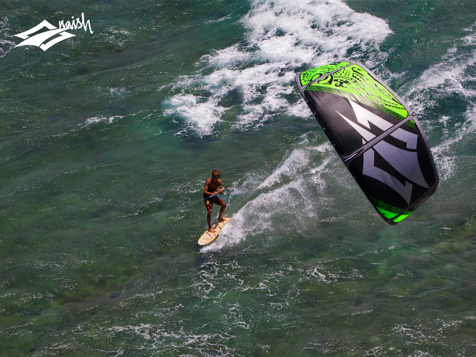 kitesurf wallpaper image - Kai Lenny cruising with the Naish Park kite and Alaia kiteboard off Hawaii - in resolution: Standard 4:3 1600 X 1200