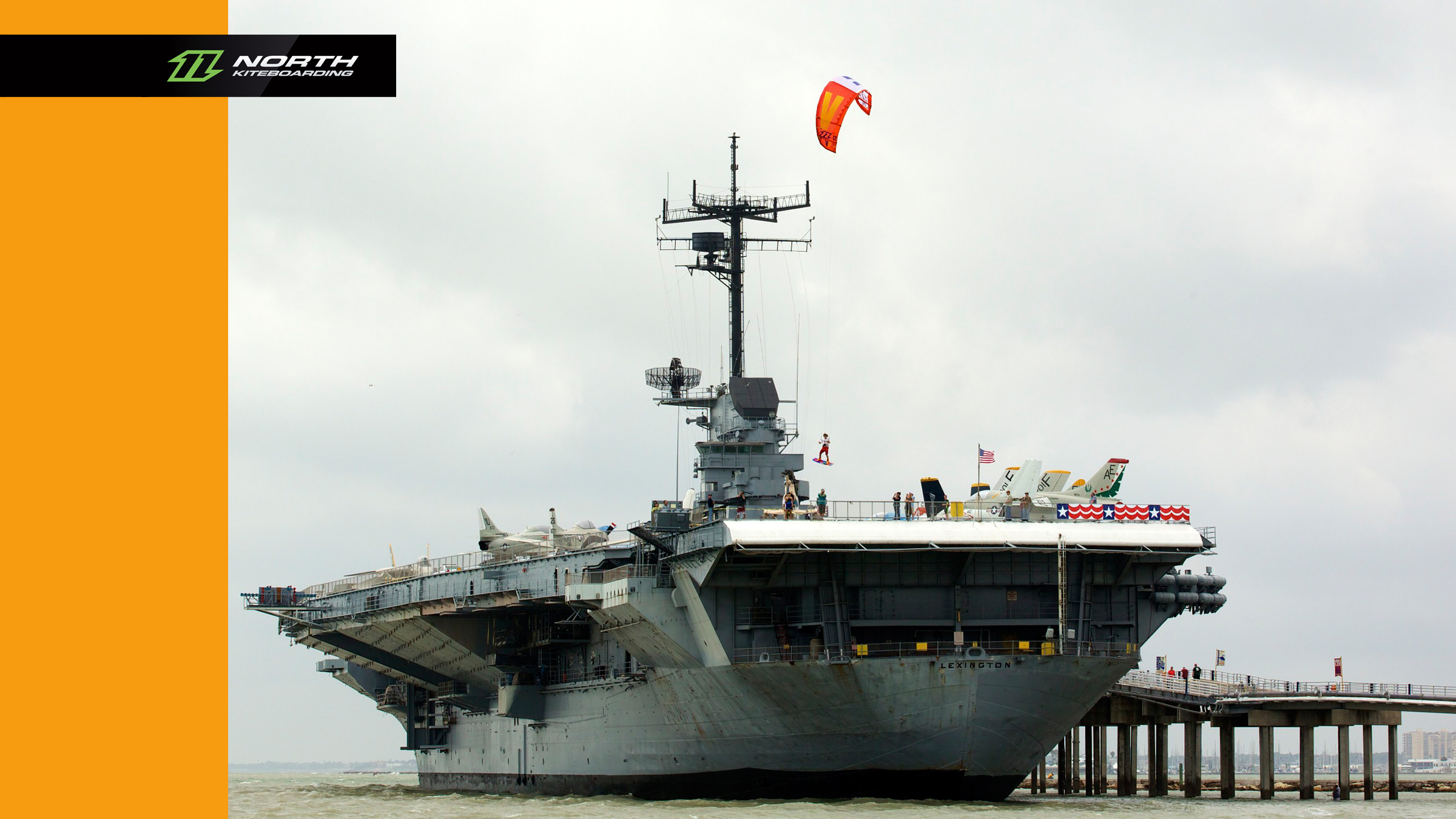 kitesurf wallpaper image - Jumping off an aircraft carrier with a North Vegas kite - in resolution: High Definition - HD 16:9 2400 X 1350