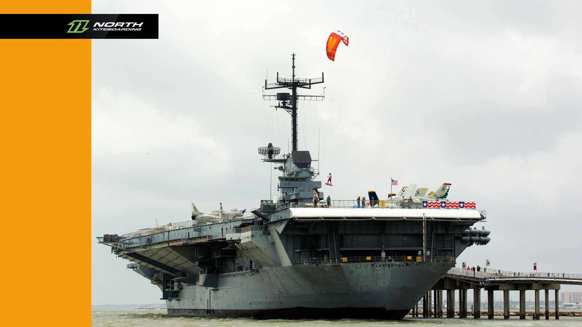 kitesurf wallpaper image - Jumping off an aircraft carrier with a North Vegas kite - in resolution: High Definition - HD 16:9 1920 X 1080