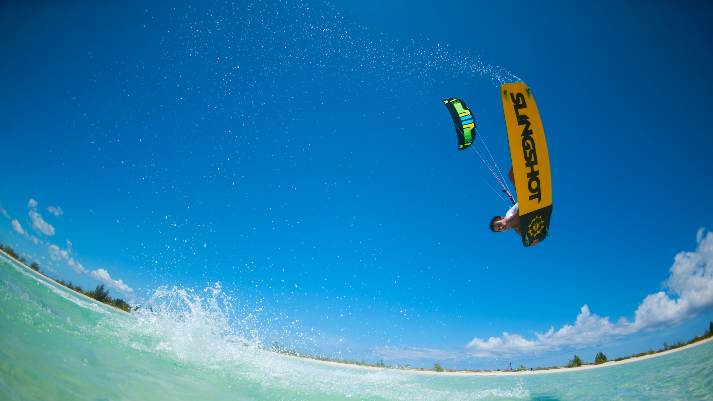kitesurf wallpaper image - Kiteboarder Victor Hays with a jump and tail grab on the 2016 Slingshot Rally kite and Misfit kiteboard. - in resolution: High Definition - HD 16:9 2400 X 1350
