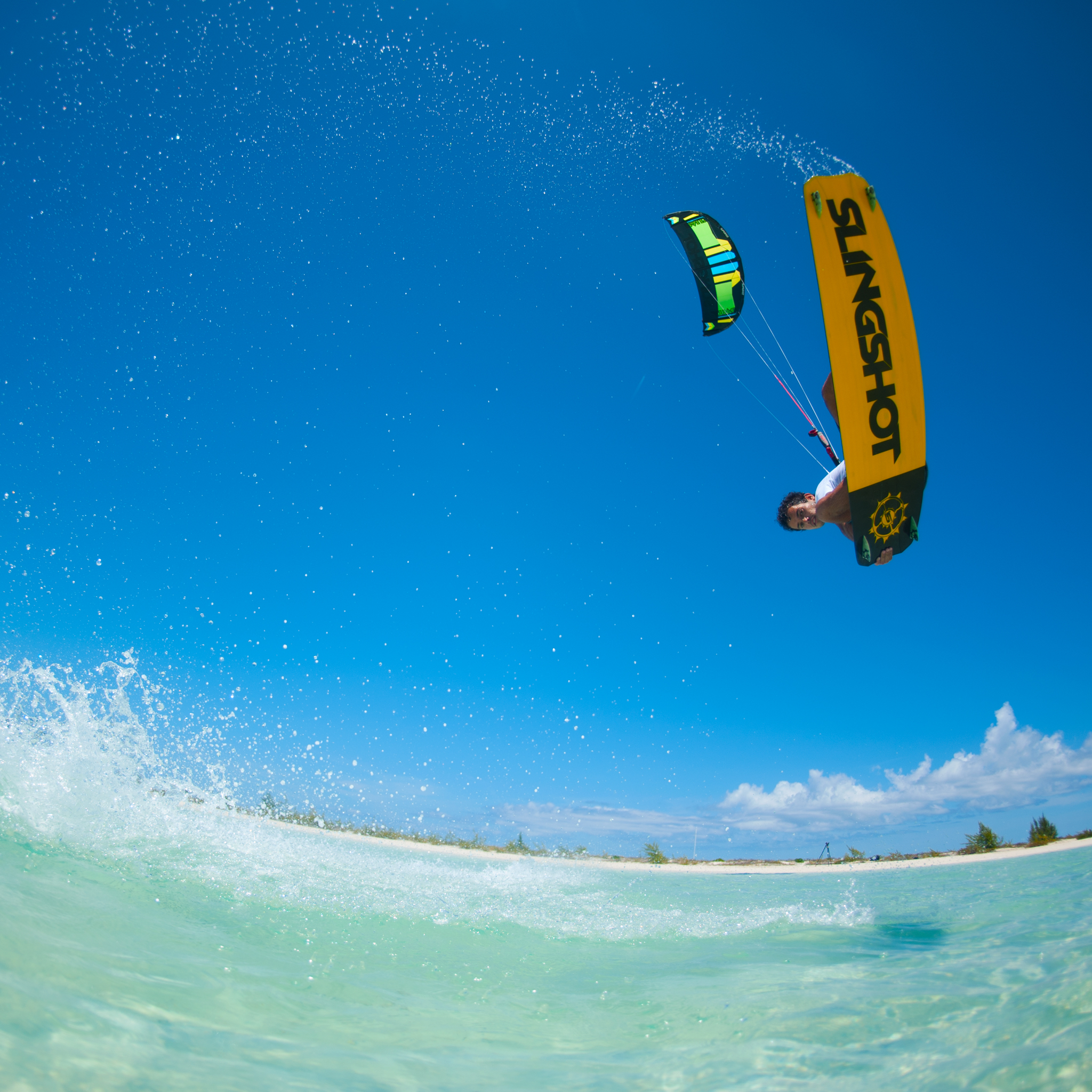 kitesurf wallpaper image - Kiteboarder Victor Hays with a jump and tail grab on the 2016 Slingshot Rally kite and Misfit kiteboard. - in resolution: iPad 2 & 3 2048 X 2048