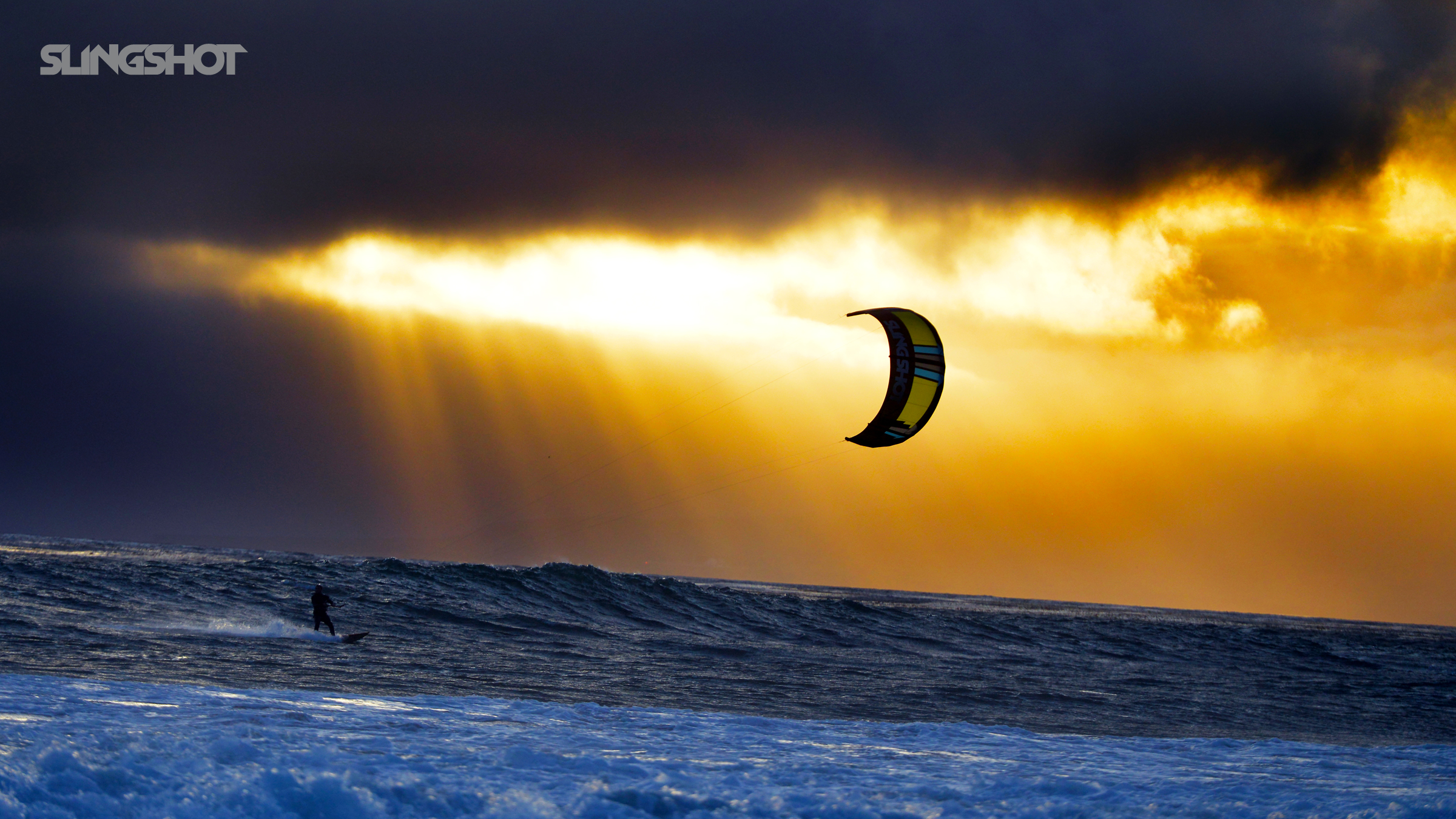 kitesurf wallpaper image - A kitesurfer cruising at sunset with his 2016 Slingshot Wave SST kite. - in resolution: High Definition - HD 16:9 2400 X 1350