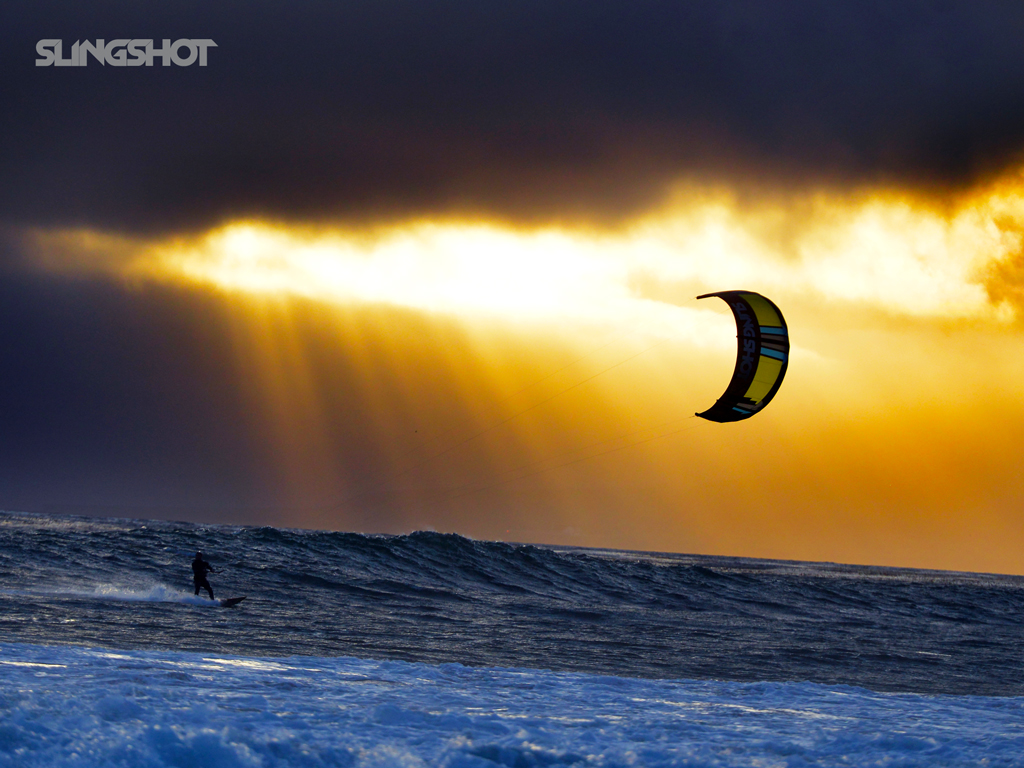 kitesurf wallpaper image - A kitesurfer cruising at sunset with his 2016 Slingshot Wave SST kite. - in resolution: iPad 1 1024 X 768