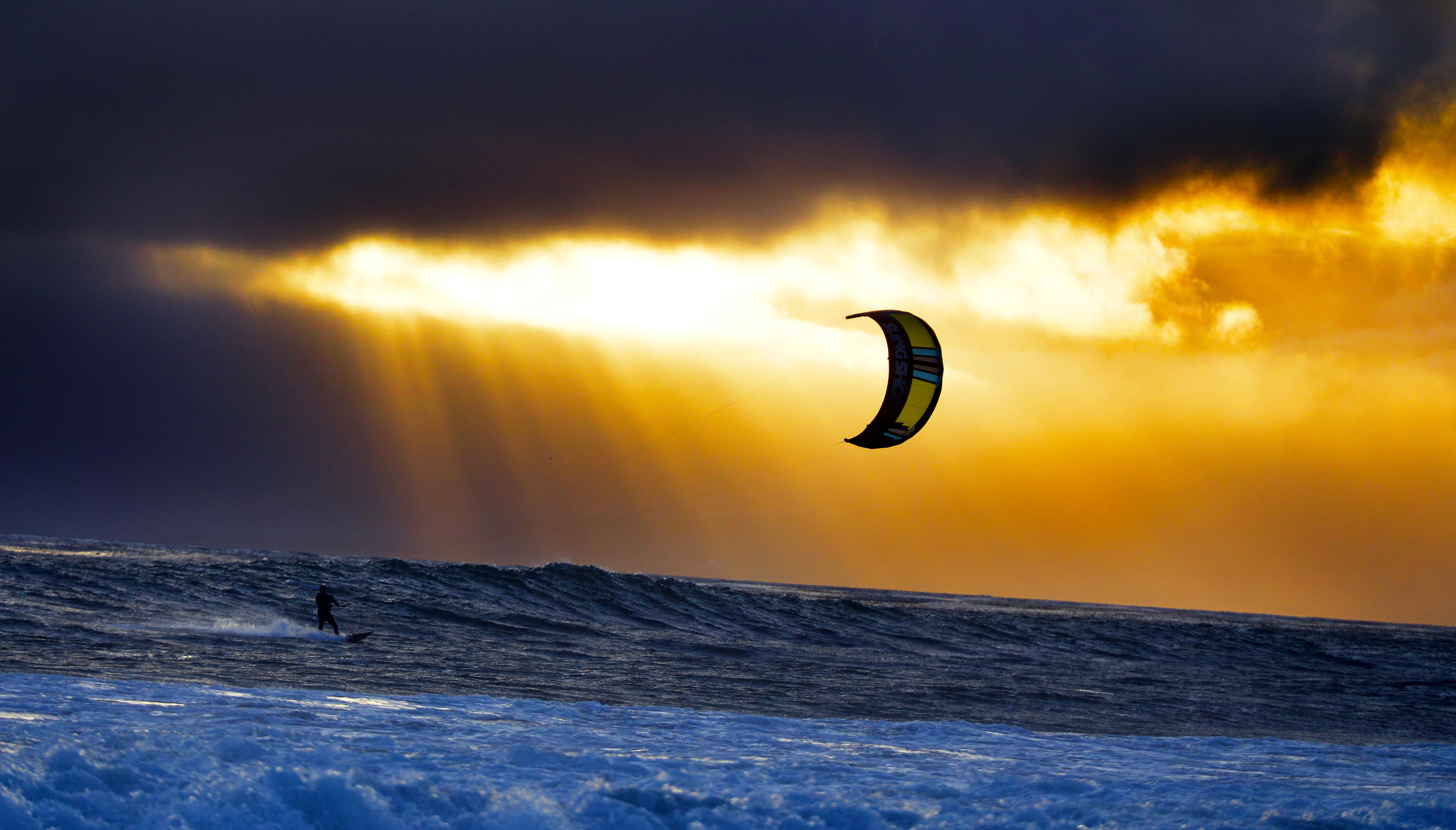 kitesurf wallpaper image - A kitesurfer cruising at sunset with his 2016 Slingshot Wave SST kite. - in resolution: Original 5776 X 3292