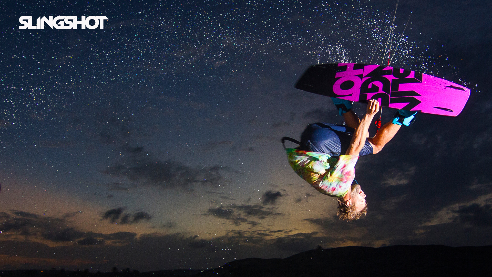 kitesurf wallpaper image - Sam Light on the 2015 Slingshot asylum board. Inverted with a grab kitesurfing. - in resolution: High Definition - HD 16:9 1920 X 1080