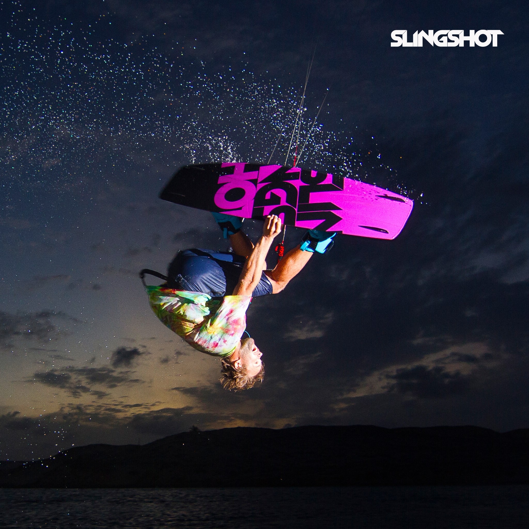 kitesurf wallpaper image - Sam Light on the 2015 Slingshot asylum board. Inverted with a grab kitesurfing. - in resolution: iPad 2 & 3 2048 X 2048