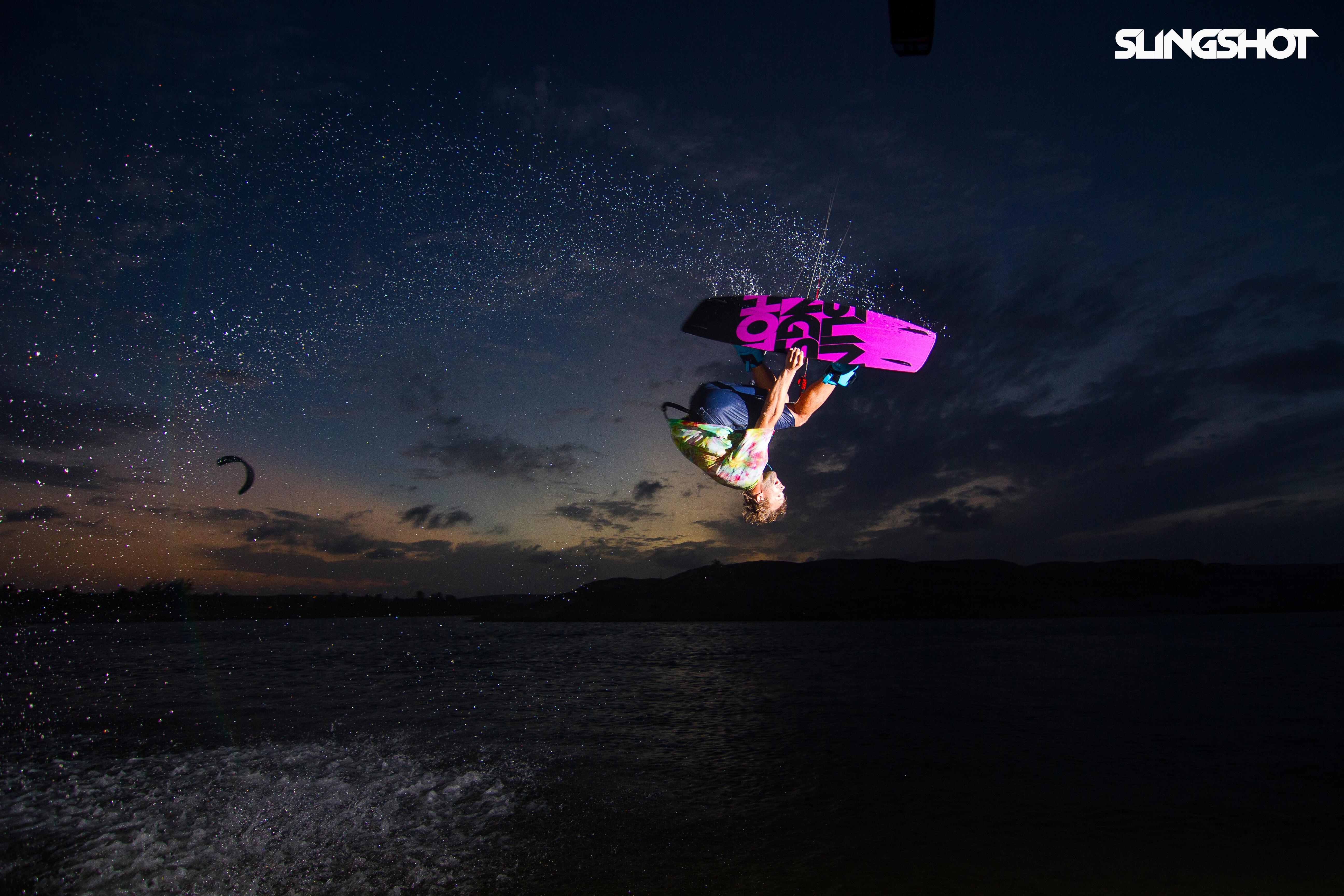 kitesurf wallpaper image - Sam Light on the 2015 Slingshot asylum board. Inverted with a grab kitesurfing. - in resolution: Original 5184 X 3456