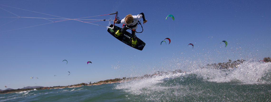 Wake style kiteboarding photo