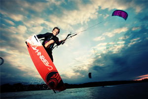 Damien LeRoy with a tailgrab at dusk on his Cabrinha kites gear