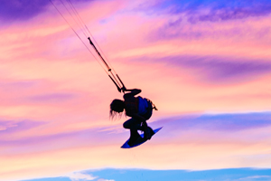 Indie grab at sunset with Tona Boards - kitesurfing